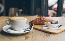 Coffee, Croissant and jam on a wooden table